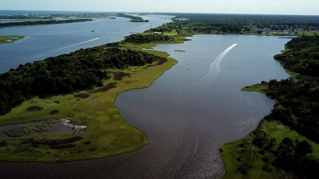 ariel view of jet ski on intracoastal waterway in holly ridge, nc - inlet stock videos & royalty-free footage