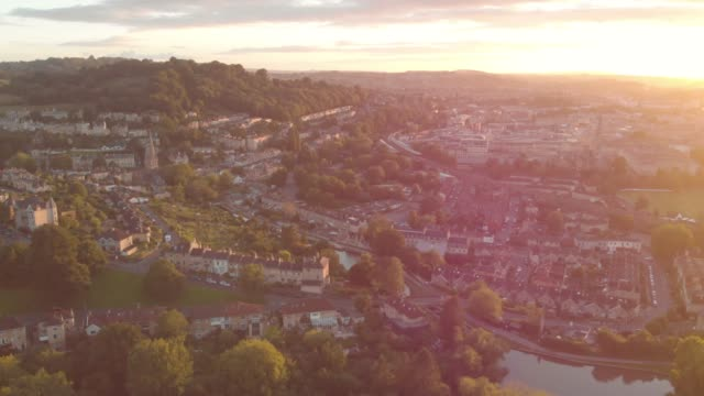 ariel views of buildings in the city centre of the british town of bath at golden hour in somerset, united kingdom. - dusk stock videos & royalty-free footage