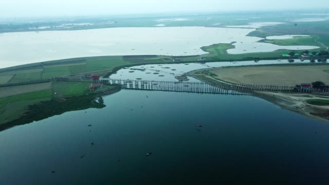 aries view u bein bridge crossing the taungthaman lake near amarapura in myanmar,oldest and longest teakwood bridge in the world - uranium stock videos & royalty-free footage