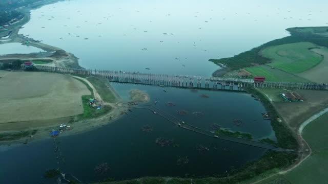 aries view u bein bridge crossing the taungthaman lake near amarapura in myanmar,oldest and longest teakwood bridge in the world - myanmar stock videos & royalty-free footage