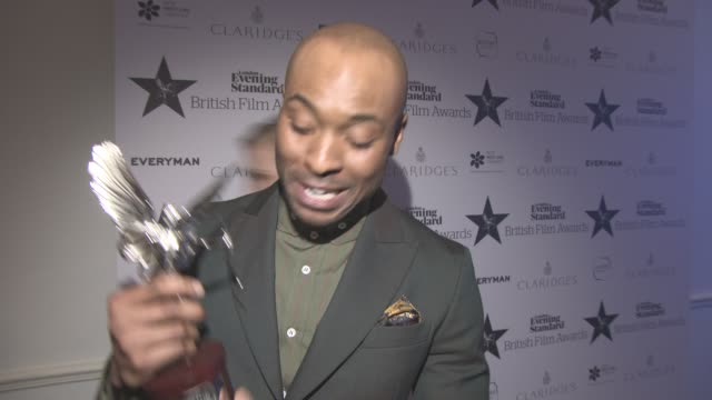 interview arinze kene on winning best supporting actor premiere league for coming out gay soon at evening standard film awards at claridge's hotel on... - best supporting actor stock videos & royalty-free footage