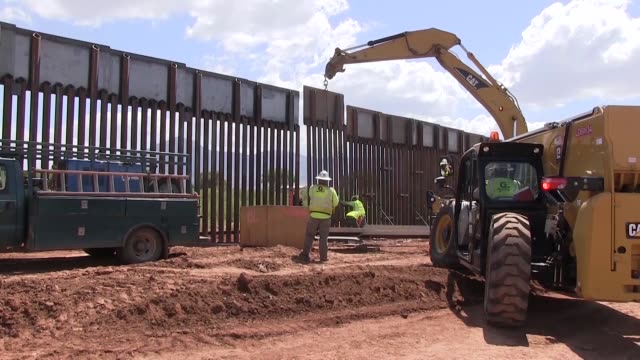 tucson ariz – construction crews installed the final border fence panel earlier today completing the replacement of an estimated 75 miles of outdated... - wall building feature stock videos and b-roll footage