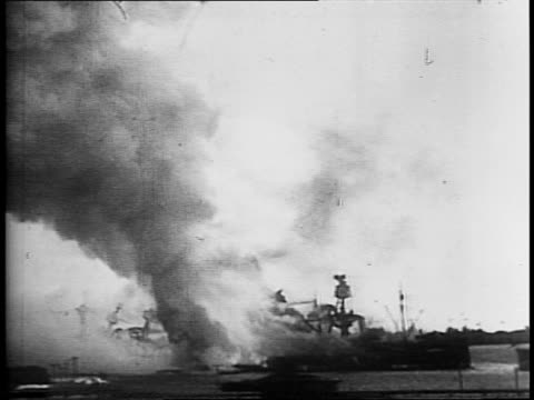 uss arizona at sea / fires on the shore during pearl harbor attack / japanese warplane flying over pearl harbor / the uss arizona exploding /... - 真珠湾攻撃点の映像素材/bロール