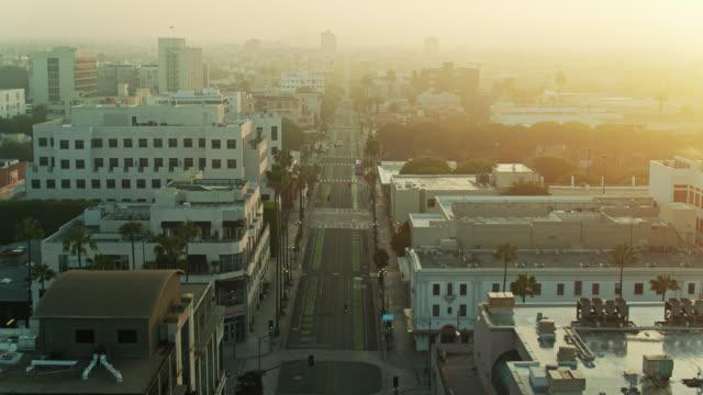 arizona avenue, santa monica at sunrise during the covid-19 lockdown - aerial - urban road stock videos & royalty-free footage