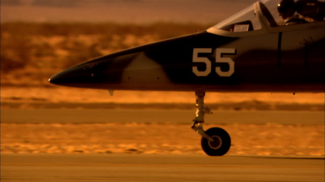 cu, usa, arizona, grand canyon, aero l-39 albatross driving down runway - military aeroplane stock videos and b-roll footage