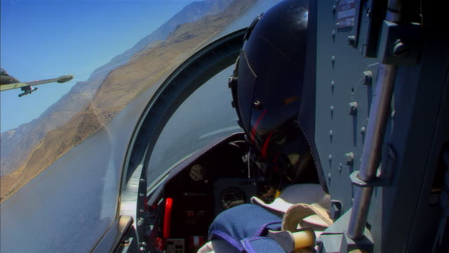 pov, usa, arizona, grand canyon, aero l-39 albatross  flying above mountains and lake - us airforce stock videos & royalty-free footage