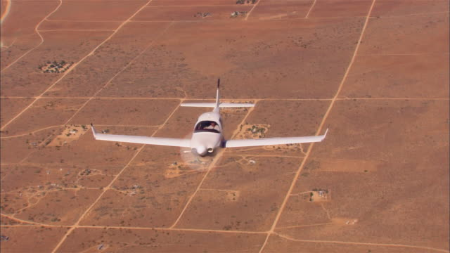 air to air, ha, usa, arizona, grand canyon, lancair legacy flying over desert - unknown gender stock videos & royalty-free footage