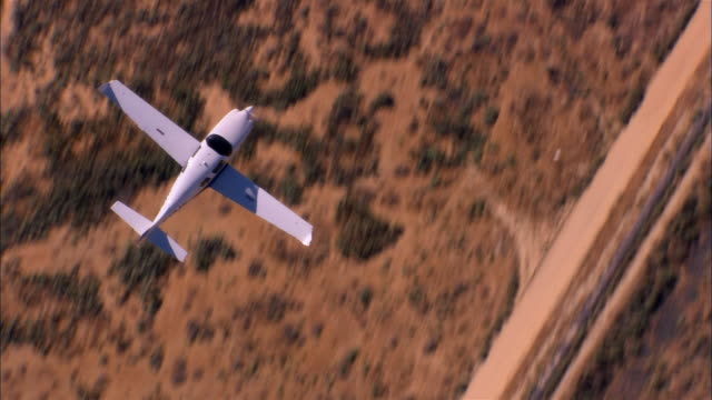 air to air, ha, usa, arizona, grand canyon, lancair legacy flying over desert - propeller aeroplane stock videos & royalty-free footage
