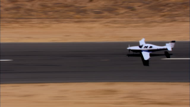 TS, HA, USA, Arizona, Grand Canyon, Lancair Legacy taking off from runway in desert