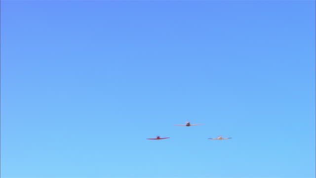 LA, MS, USA, Arizona, Grand Canyon, Three Lancair Legacy airplanes flying against clear sky in perfect formation