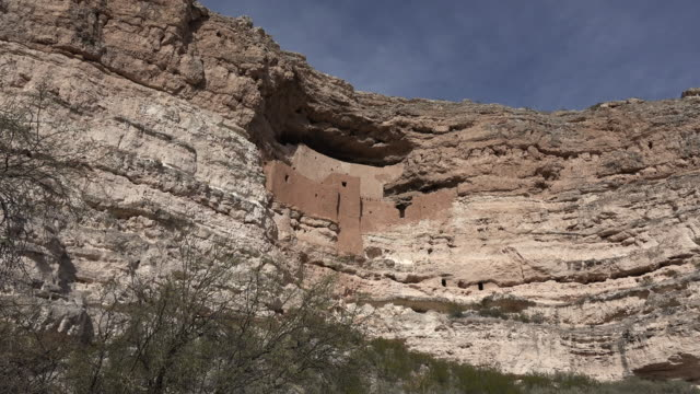 arizona montezuma castle cliff dwelling with sky.mov - cliff dwelling stock videos & royalty-free footage