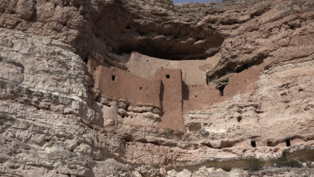 arizona montezuma castle cliff dwelling zoom in.mov - cliff dwelling stock videos & royalty-free footage