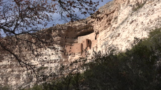 arizona montezuma castle framed with leaves zoom in.mov - cliff dwelling stock videos & royalty-free footage