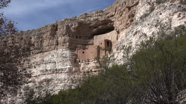 arizona montezuma castle with shrub zoom out.mov - cliff dwelling stock videos & royalty-free footage