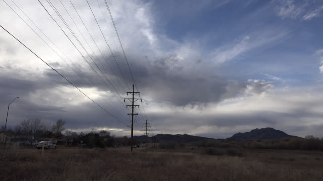 arizona power lines and dramatic sky time lapse - telegraph pole stock videos and b-roll footage