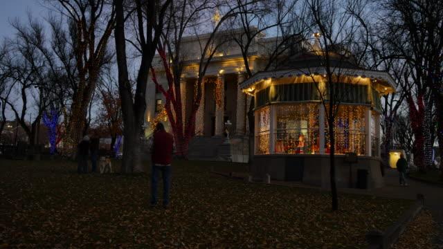 arizona prescott christmas lights with people and dog - prescott arizona stock videos & royalty-free footage