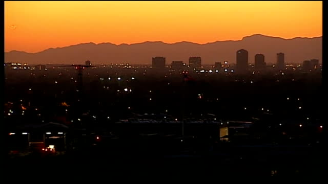 rise in kidnaps and violence linked to border drug wars; phoenix: ext/night high angle shot of phoenix city skyline graphicised shot of city lights... - recreational drug stock videos & royalty-free footage