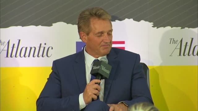Arizona Senator Jeff Flake answers a question by Constitution Center CEO Jeffrey Rosen at an event as an FBI supplemental investigation was underway...