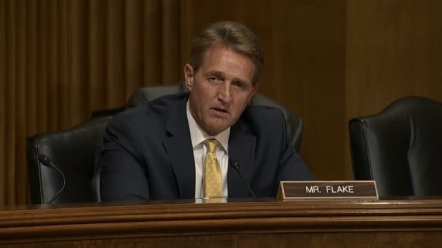 Arizona Senator Jeff Flake questions Secretary of State Mike Pompeo at a Senate Foreign Relations Committee hearing about North Korean commitments to...