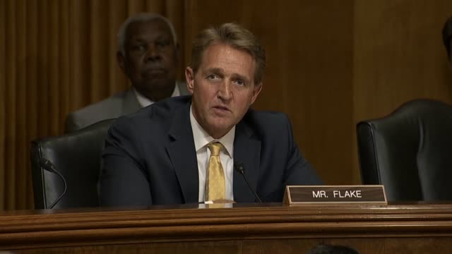 Arizona Senator Jeff Flake questions Secretary of State Mike Pompeo at a Senate Foreign Relations Committee hearing about Rwanda and the restriction...