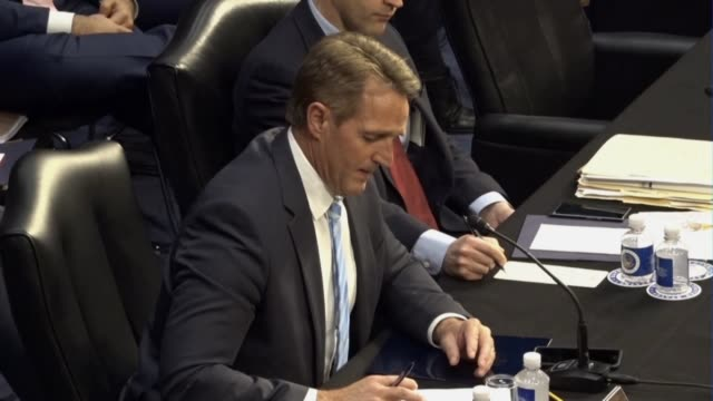 Arizona Senator Jeff Flake reads from a prepared statement at a meeting of the Senate Judiciary Committee prior to a vote on sending the nomination...
