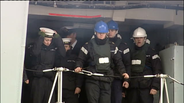 ark royal returns home for last time 'ark royal' on side of ship and crewman at hatch above red and blue balloons crew waiting at top of gangway bv... - captain scarlet stock videos and b-roll footage