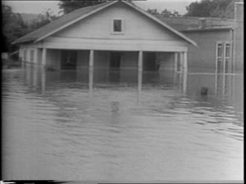 Arkansas / aerial view of flood / montage of streets and houses / horse and mule auction house and Van Buren train station under water / headlines...