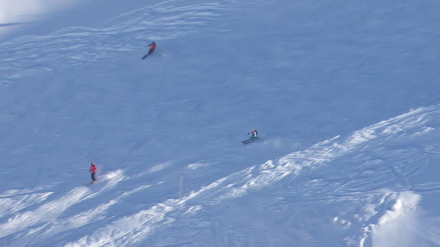 Arlberg - Skiers coming down a mountain in Lech