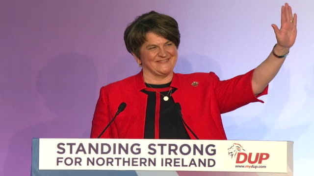 arlene foster speaking about the brexit backstop deal at dup conference, boris johnson sat in audience - dup stock-videos und b-roll-filmmaterial