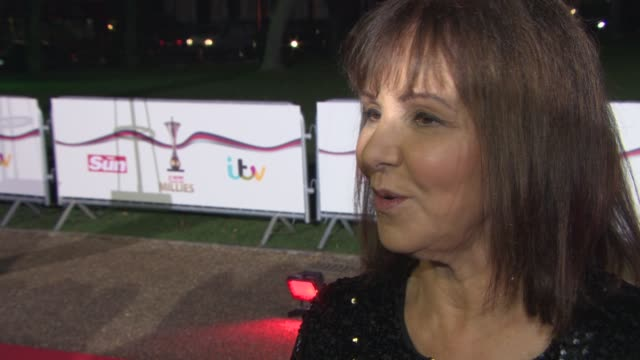arlene phillips on supporting the men and women of the armed forces, who she thinks will win strictly come dancing at the sun military awards at... - ストリクトリーカムダンシング点の映像素材/bロール