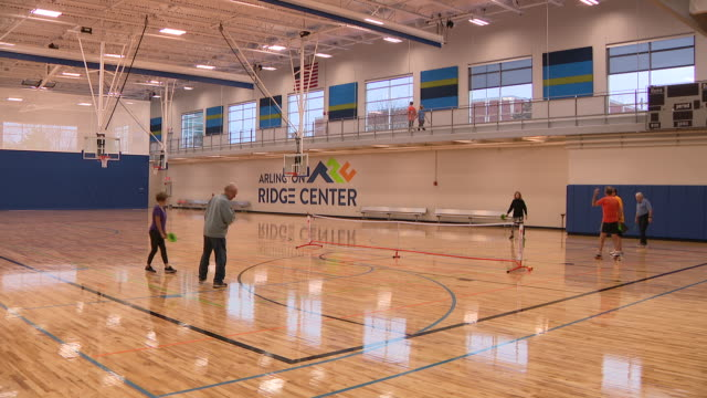 wgn arlington heights il us people playing pickleball in arlington ridge center in arlington heights illinois on saturday january 4 2020 - athleticism stock videos & royalty-free footage