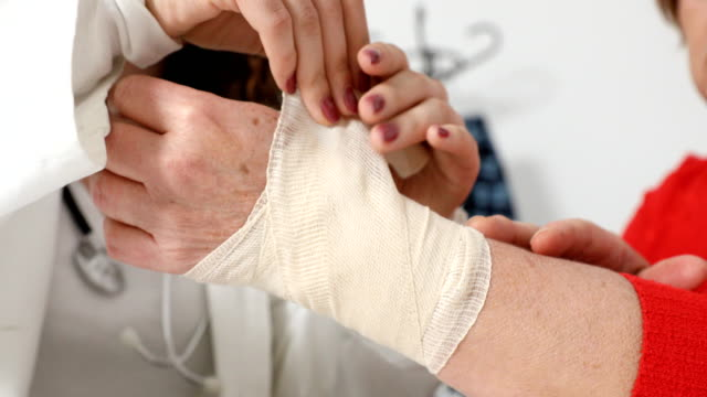 arm injury treated with bandage - bandage stock videos & royalty-free footage