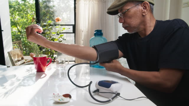 arm of elderly man that measuring blood pressure, healthcare concept. - blood pressure gauge stock videos & royalty-free footage