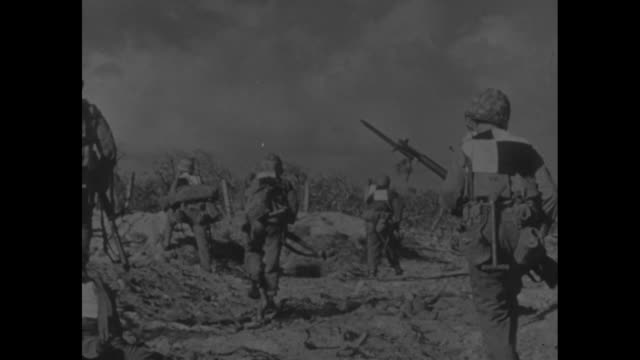 vs armada of amphibious landers filled with soldiers / vs on shore tanks artillery / soldiers with big checkerboard targets on backs make way up... - japanese military stock videos & royalty-free footage