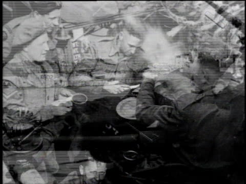vidéos et rushes de armada of landing craft at sea / soldier taking nap lying on naval gun / group of soldiers dishing out soup from kettle / soldiers sitting under... - world war 1