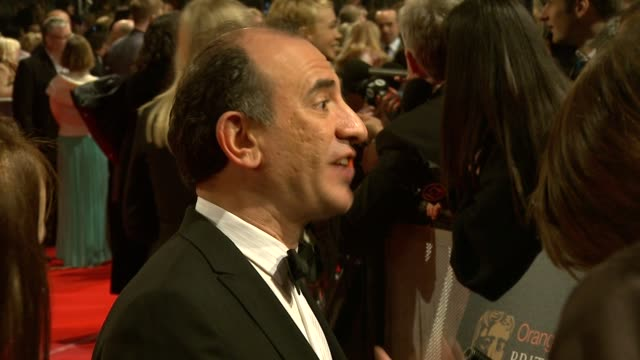 vídeos y material grabado en eventos de stock de armando iannucci at the the orange british academy film awards at london england - armando iannucci
