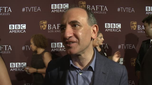 vídeos y material grabado en eventos de stock de interview armando iannucci on the importance of being at tonight's bafta event and on their favorite television moments from this past season at the... - armando iannucci