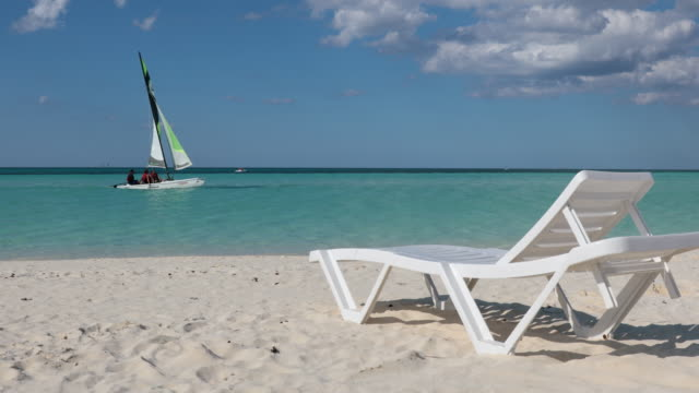 armchair on tropical beach, cayo coco cuba - outdoor chair stock videos & royalty-free footage