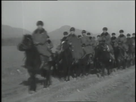 armed chinese troops ride through the countryside. - manchuria region stock videos & royalty-free footage