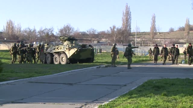 armed forces backed by armoured vehicles broke inside a ukrainian airbase in crimea on saturday firing from automatic weapons into the air an afp... - sevastopol crimea stock videos and b-roll footage