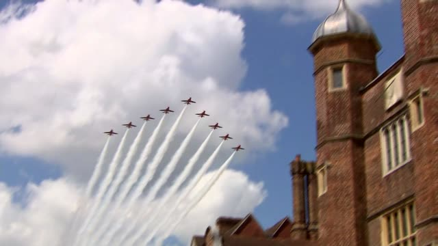 armed forces day: guildford parade and fly-past; england: surrey: guildford: int crowds lining street / flypast by the red arrows / people and police... - guildford stock videos & royalty-free footage