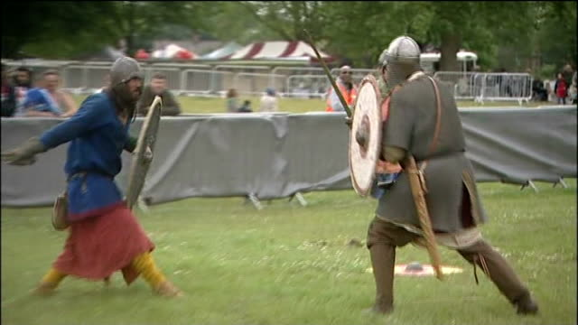 armed forces day / gvs event in nottingham; england, nottinghamshire nottingham, ext gvs fair held in field / gvs re-enactment of saxon sword fight... - historical reenactment stock videos & royalty-free footage