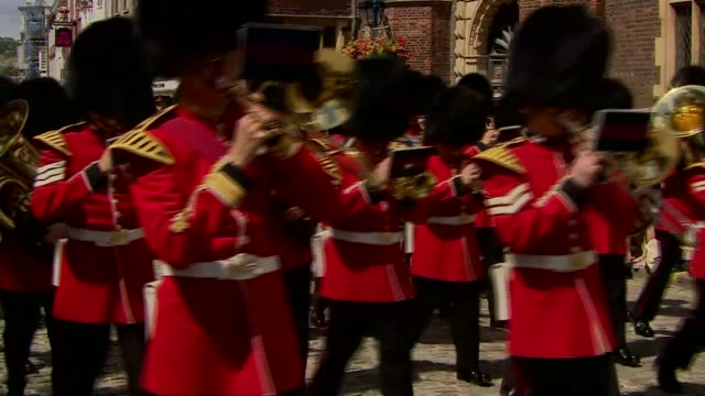 armed forces day planned attack foiled by police military guards along wearing bearskin hats and playing in brass band - itv london tonight weekend点の映像素材/bロール