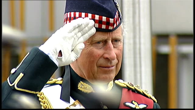 stockvideo's en b-roll-footage met armed forces day prime minister david cameron mp and first minister alex salmond msp watching parade prince charles in uniform saluting as parade... - militair uniform