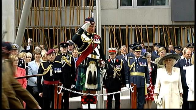 prince charles and camilla at parade in edinburgh; scotland: edinburgh: ext prince charles on dais taking royal salute, marching band and servicement... - pavement点の映像素材/bロール