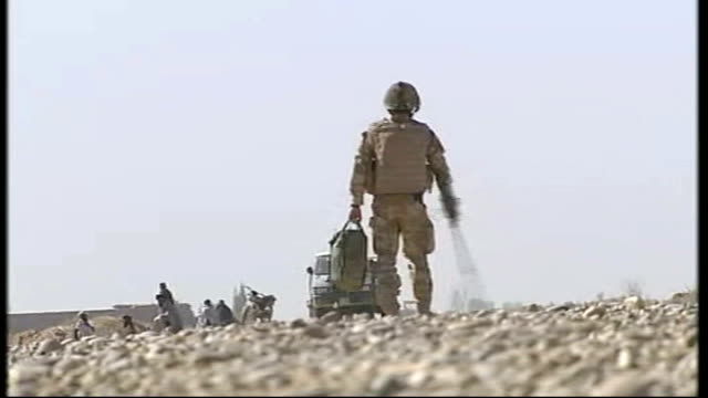 armed forces day; t12031001 afghanistan: helmand province: improvised explosive device being exploded on road leading to british army base low angle... - helmand stock videos & royalty-free footage