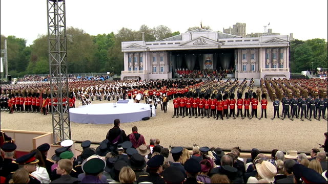 armed forces parade to mark queen's diamond jubilee; general views of various marching bands on parade / queen's car along - diamantenes jubiläum stock-videos und b-roll-filmmaterial
