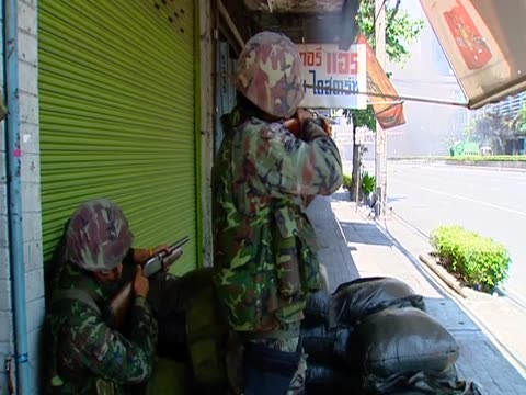 armed forces shoot at anti-government protesters during violent clashes thailand; 15 may 2010 - violence stock videos & royalty-free footage