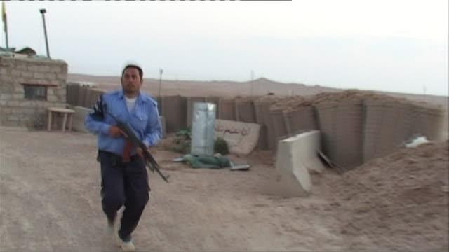 ws shaky armed iraqi officer running through patrol site, haditha, al anbar, iraq - iraq stock videos & royalty-free footage