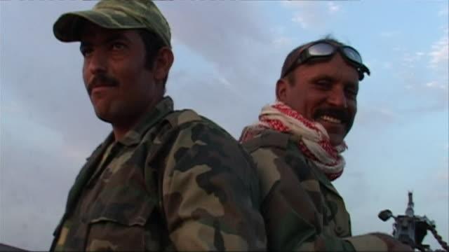 CU LA Armed Iraqi soldiers smiling under blue sky, Haditha, Al Anbar, Iraq